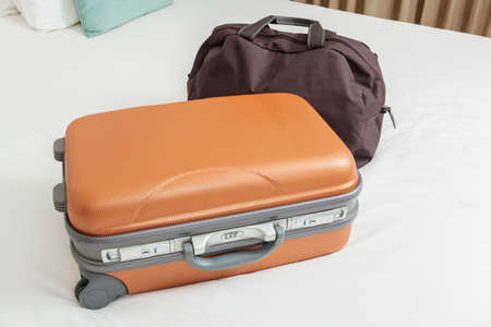 business suitcase on bed for traveling photo