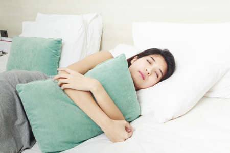 young beautiful Asian woman sleeping in bed Stock Photo - 26247726