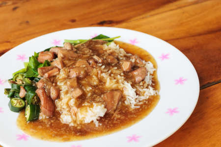 Thailand traditional food, rice with chicken sauce photo