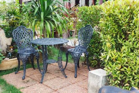 country house: Garden table and chairs Stock Photo