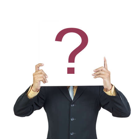 Business man holding question sign or present showing over head on white background photo