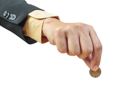business man hand putting coin on white background photo