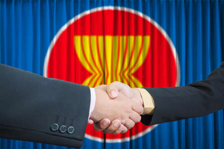 asean: ASEAN Economic Community in businessman handshake