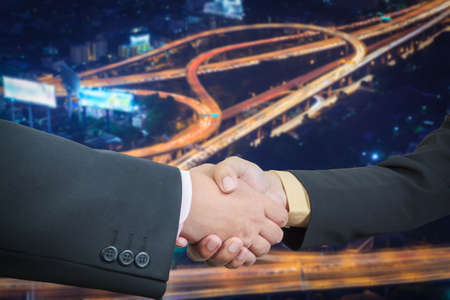 Businessman handshake with power or energy transportation logistic background photo