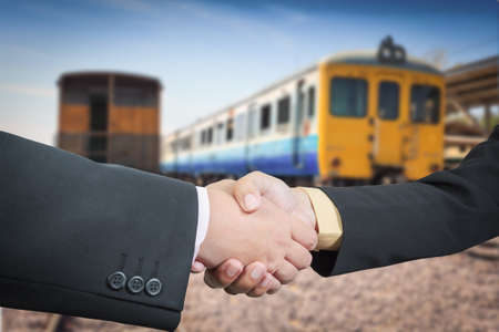Businessman handshake with train transportation logistic background photo