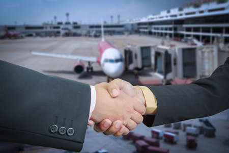 Businessman handshake with air plane transportation logistic background photo