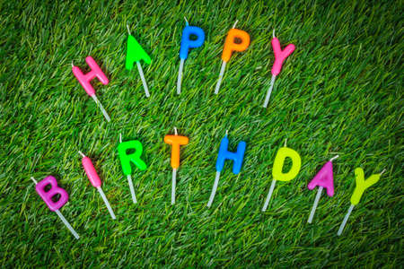 happy birthday candles: Colorful happy birthday candles on field Stock Photo