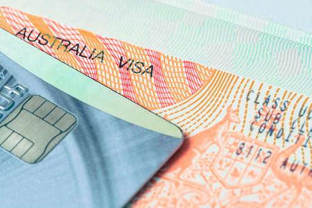 authorisation: Passport stamp visa and credit card for travel concept background, Australia