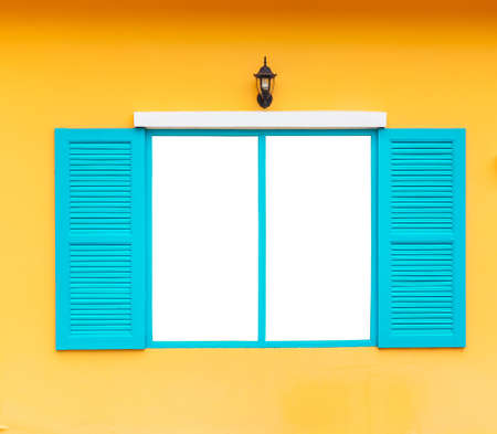 open blank window frame on wall with lamp, blue color photo