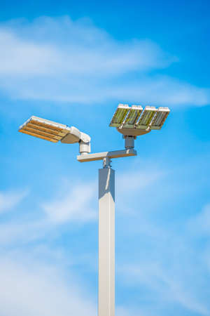 LED street lamps post on blue sky background photo