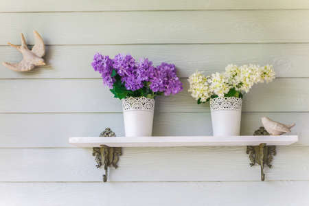 colorful flowers in pots vintage on wall photo