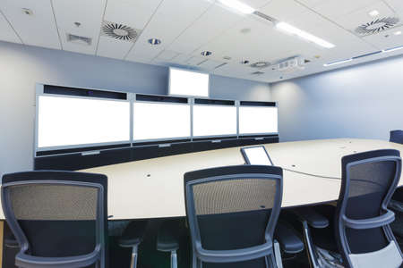 teleconferencing, video conference and telepresence business meeting room with blank screen display monitor photo