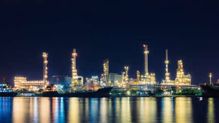 Oil refinery at twilight, business logistic concept