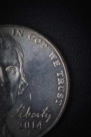 in god we trust: US American coin with wording in God we trust on black background