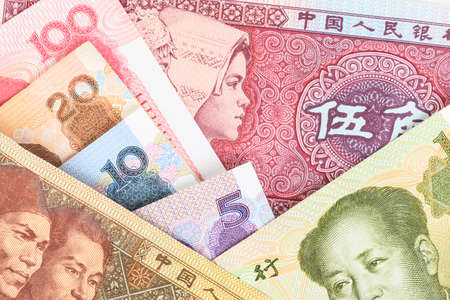 appears: Chinese or Yuan banknotes money  from Chinas currency, close up view as background