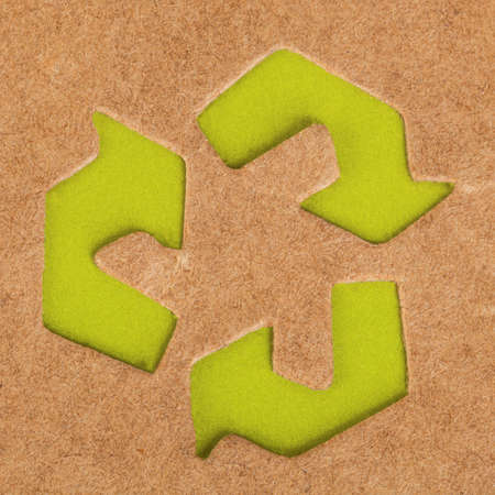 green recycle symbol on cardboard box background photo
