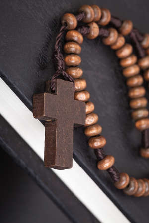 christian festival: Christian cross necklace on Holy Bible book, Jesus religion concept as good friday or easter festival