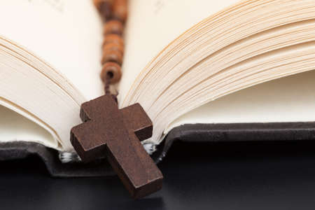 Christian cross necklace on Holy Bible book, Jesus religion concept as good friday or easter festival photo