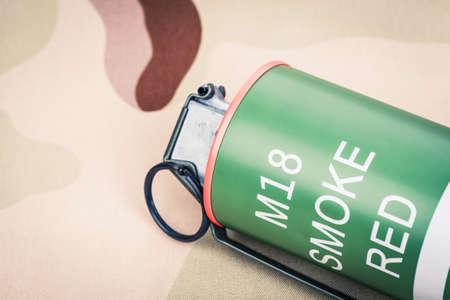 Smoke grenade red color M18,frag explosion