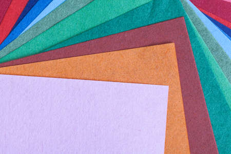 Abstract colorful origami paper pattern texture stacked layer respective, as background photo