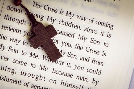 psalm: Christian cross necklace on Holy Bible book, Jesus religion concept as good friday or easter festival