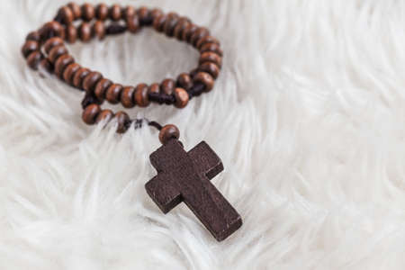 psalm: Christian cross necklace on sheep wool, Jesus religion concept as good friday or easter festival