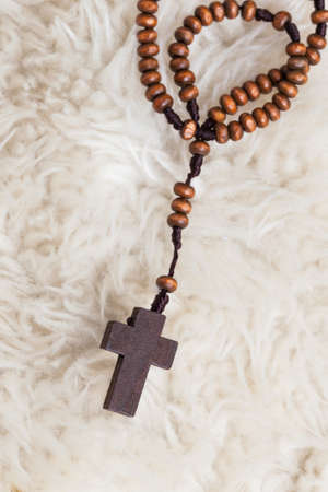 hymn: Christian cross necklace on sheep wool, Jesus religion concept as good friday or easter festival