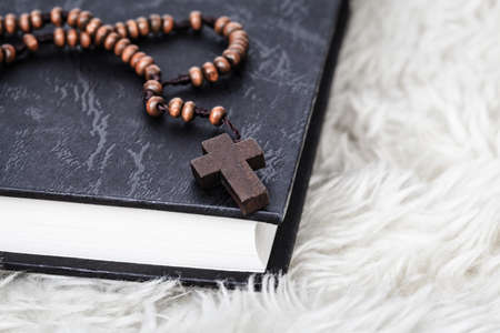 hymn: Christian cross necklace on Holy Bible book, Jesus religion concept as good friday or easter festival