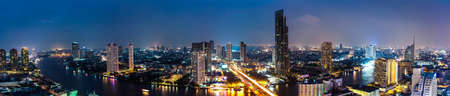 Business Building Bangkok city area at night life with transportation car and ship as panorama, high angle bird eyes view photo
