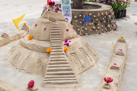 Sand pagoda ceremony, Cultural activities including sand sculpture for Songkran festival photo