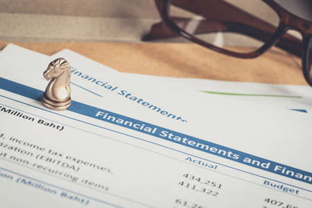 financial statement: Financial statement letter on brown envelope and eyeglass business concept document is mockup