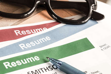 Resume letter background and glasses pen can use as recruitment business concept Stock Photo