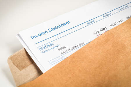 business letter: Income statement letter in brown envelope opening business concept document is mockup Stock Photo