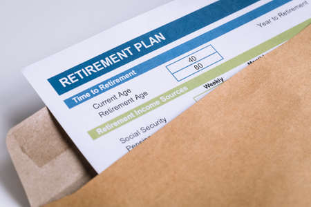 Retirement Planning letter in brown envelope opening business concept Standard-Bild