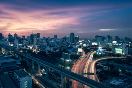 land pollution: Business Building Bangkok city area at night life with transportation way logistic concept high angle bird eyes view Stock Photo