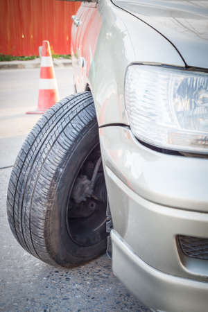 front bumper: Car crash accident impact to front wheel axle and bumper is broken cannot drive insurance concept Stock Photo