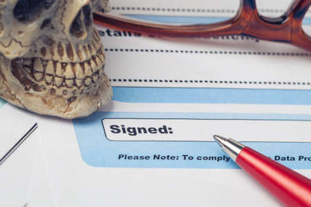signed: Signature field on document with pen and skull signed here; document is mock-up