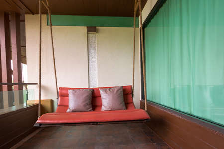 furnish: swing sofa furnish, and leather pillow for decoration and relax at balcony