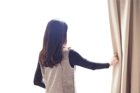 oversee: Asian portrait beautiful woman opening curtains on white background Stock Photo