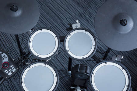 bass drum: Electronic drum set in the room corner as musical background technology theme, top view