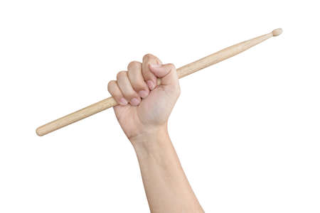 drum sticks: Male hand raising or holding drum sticks isolated on white background as musical theme