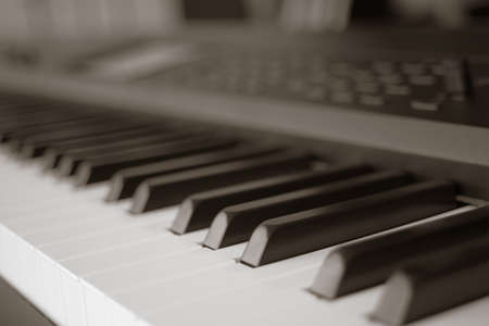 piano closeup: abstract blur of Piano Keyboard synthesizer closeup key frontal view, vintage theme Stock Photo