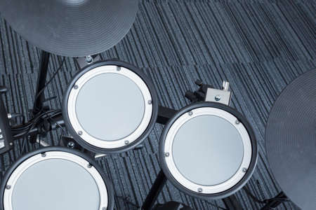 chrome base: Electronic drum set in the room corner as musical background technology theme, top view