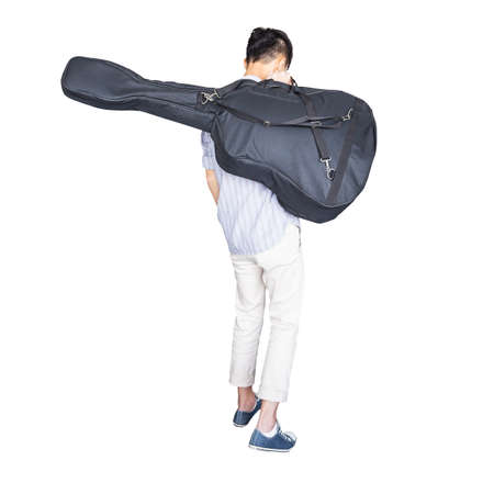strip shirt: stylish young asian hipster man wear scott strip shirt, and sneaker and walking, hold guitar bag, for concert travelling concept on white background