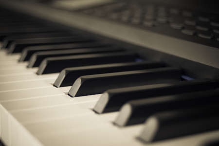 hymnal: abstract background of Piano Keyboard synthesizer closeup key frontal view Stock Photo