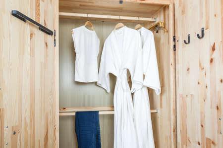 walk in closet: bathrobe and shirt, pants in wooden wardrobe
