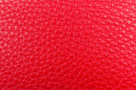 red pebble: red leather pebble texture background close up