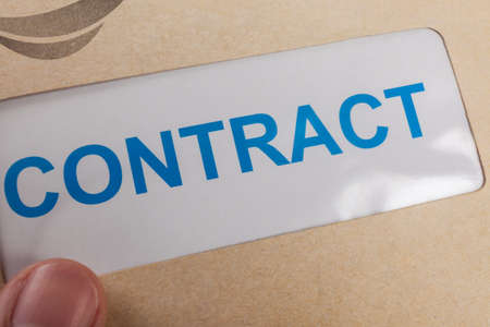 bilateral: Contract in brown envelope, can use business concept Stock Photo