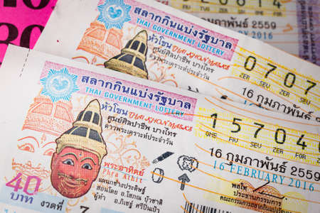 fortunate: BANGKOK, THAILAND - FEBRUARY 10, 2015: Lottery ticket sold on corrugated plastic board, in the markets of Bangkok in Thailand, on February 10, 2015