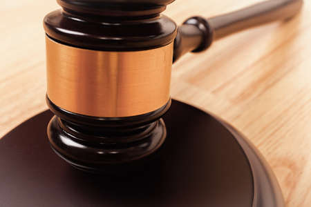 justice hammer: Justice hammer or judge gavel made from wooden on table